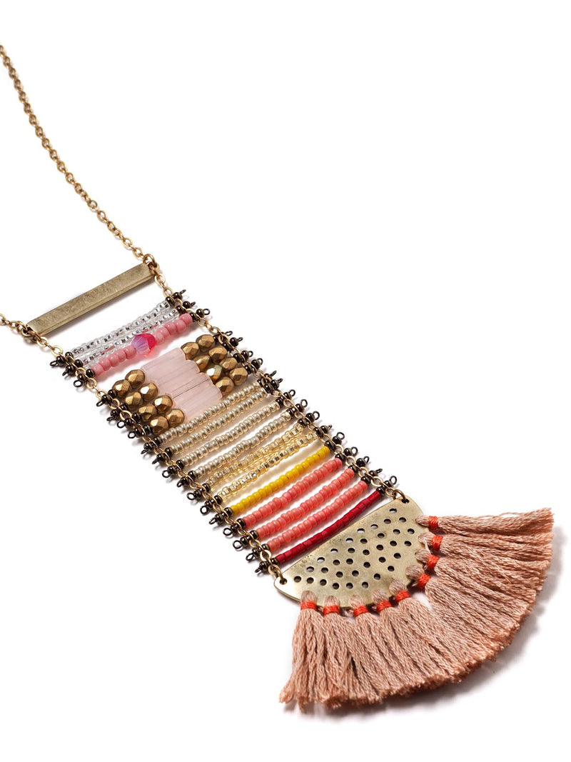 close up view of a beaded ladder necklace in antique gold with tassels