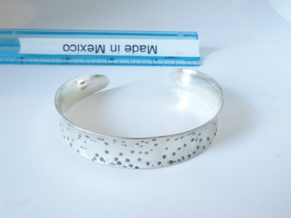 No Mas! 1.3cm x 6cm Brushed Sterling Silver Bracelet with random rustic pock