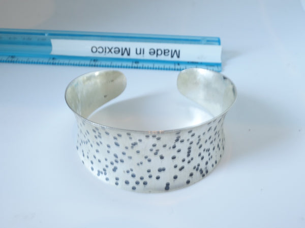 No Mas! 3cm x 6cm Brushed Sterling Silver Bracelet with random rustic pock