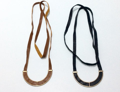 Necklace-Long suede cord with cord woven through stirrup design