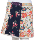 "Reversible rayon skirt with pockets (sizes 18-30 and 23"" in length)"