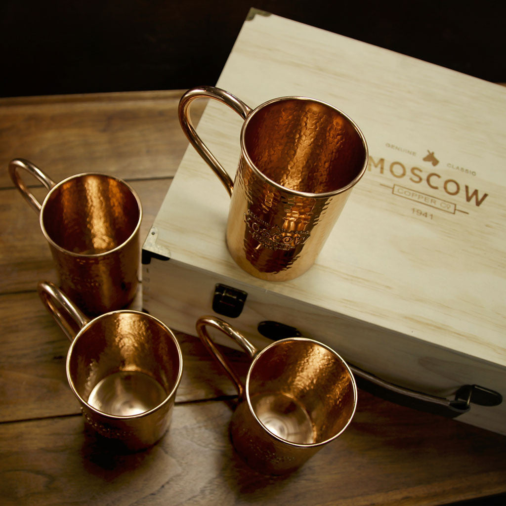 Stock up your bar with Moscow Copper Co.'s set of four hammered copper mule mugs.