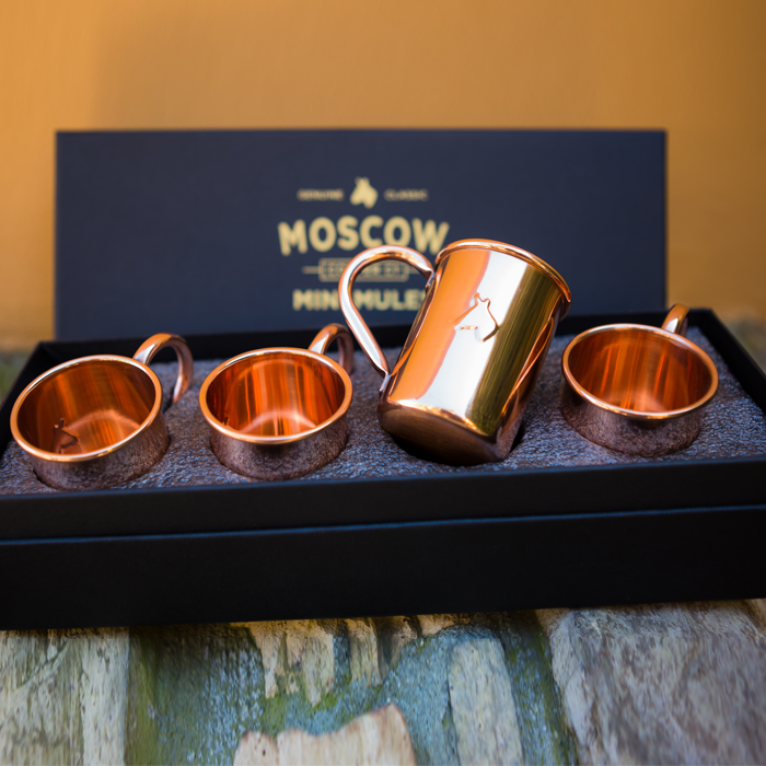 Four-pack of Moscow Copper Co. 2-ounce Mini Mule original copper mugs.