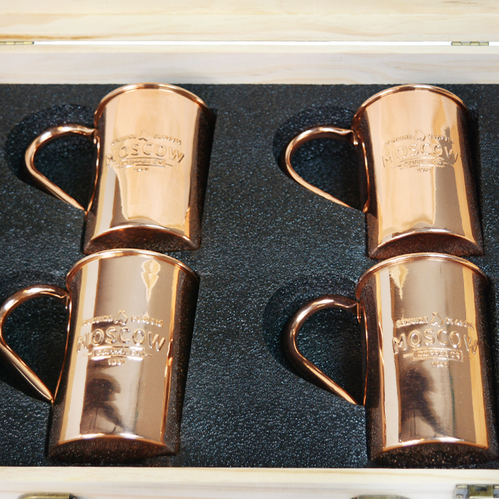 Four Moscow Copper Co. mule mugs tucked into a solid pine gift box.