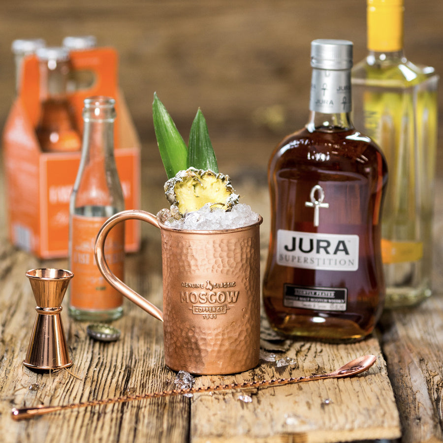 Mix up your mule with something other than vodka and a beautiful 100% original hammered copper mug.