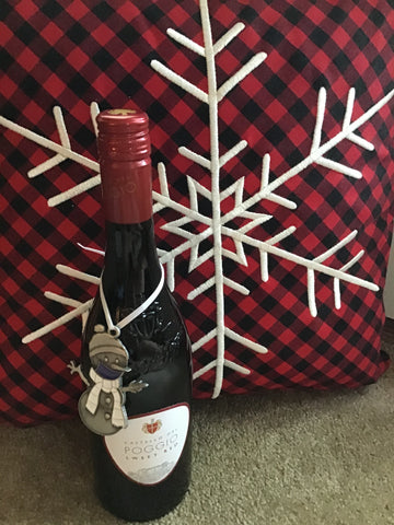 Clarence the snowman ornament on bottle of wine