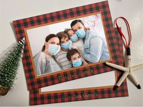 Family wearing masks in Christmas Card photo