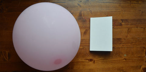 One Day Soon Time Will Have No Place Left to Hide by Christian Kiefer (Nouvella Books) and a pink balloon