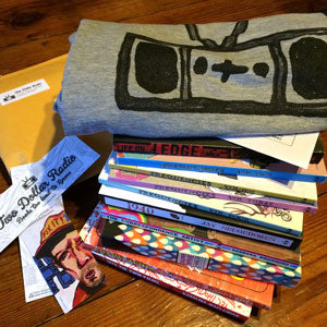 Two Dollar Radio book and shirt stack