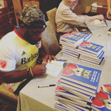 Author Hanif Abdurraqib signing copies of They Can't Kill Us Until They Kill Us