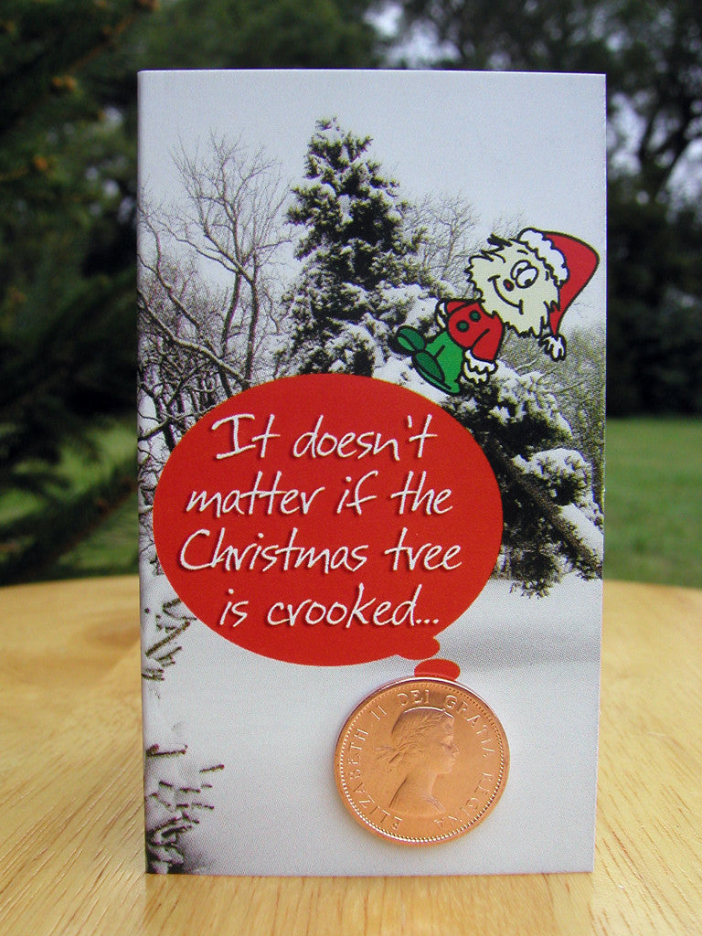#106 - Christmas card with cartoon character, leaning tree and a 98% copper coin, minted between 1953-1996! Includes envelope for mailing and descriptive postcard.