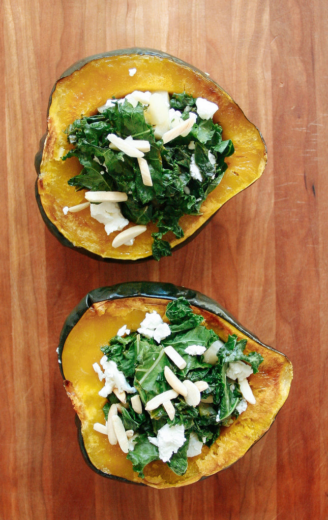 Acorn squash stuffed with kale, goat cheese, almonds, pear, cherry wood, cutting board, dinner, girls night