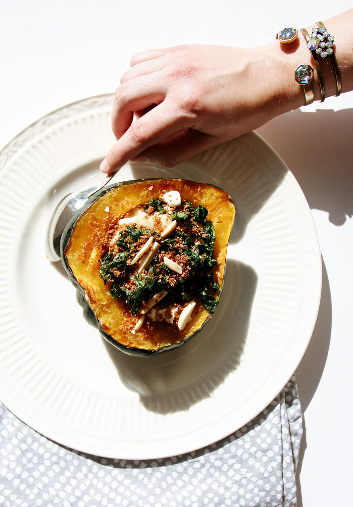 Acorn squash stuffed with kale, goat cheese, almonds, pear, bracelet, jewels, jewelry, crystal, plateware