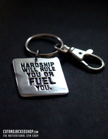Hardship will rule you or fuel you - Key Ring