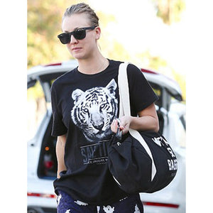 Kaley Cuoco sporting the We've All Got Baggage Duffle