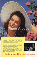 Kodachrome Film 1942 ad brunette woman in blue dress and white summer sun hat Rochester NY #237