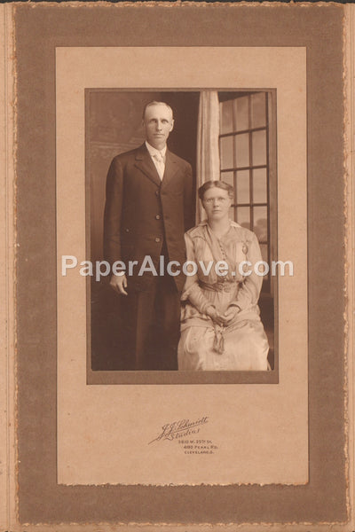 Tall man and seated woman antique studio portrait photograph c. late 19th - early 20th Century vintage original old photo J.J. Schmidt Studios Cleveland Ohio
