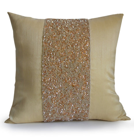 Handmade beige silk throw pillow with beads and sparkles