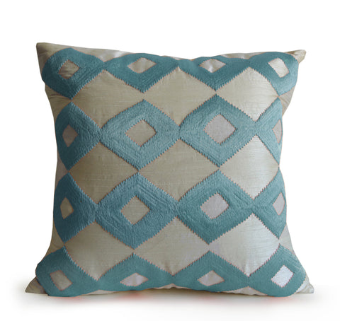 Handmade ivory faux silk cushion with blue ikat