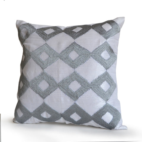 Handmade white silk silver throw pillows with ikat embroidery