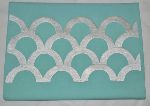 Teal colored embroidered table runner