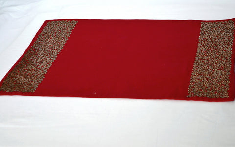 Handmade red place mats with sequin embroidery.