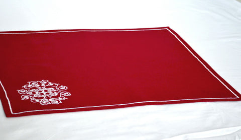 Embroidered red placemats in floral design