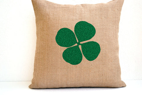 Handmade green throw pillow with beaded clover design
