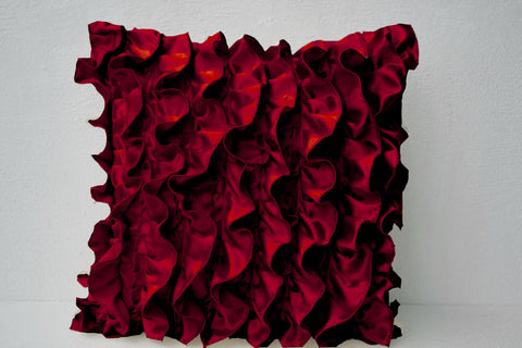 Handmade red satin throw pillow with ruffles