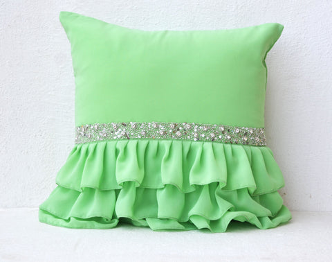Handmade green throw pillows with ruffles and sequin