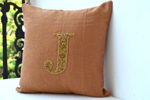 Handmade gold sequin linen cushion with monogram