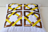 Handmade white throw pillows with geometric pattern and yellow copper sequin