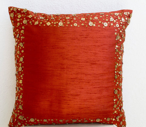 Handmade paprika rust throw pillows with gold sequin border