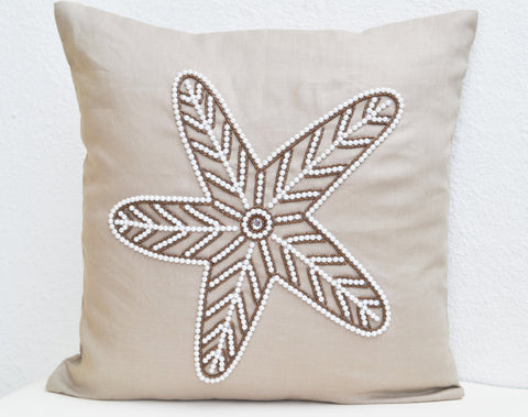 Handmade linen throw pillows with embroidered starfish