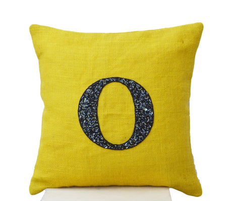 Handmade yellow throw pillow with monogram