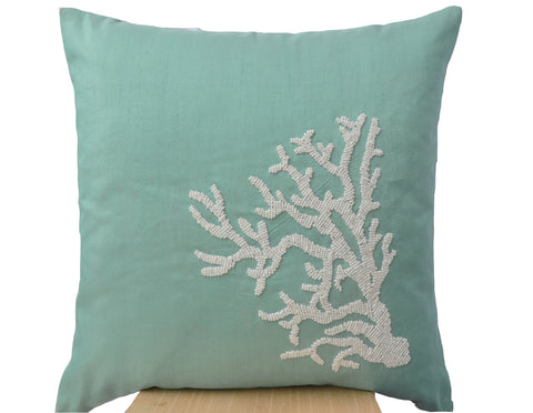 Handmade teal pillow with white coral in beads