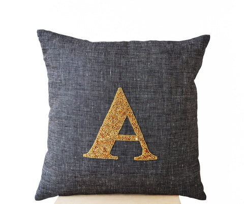 Handmade gray linen pillow with monogram and sequin