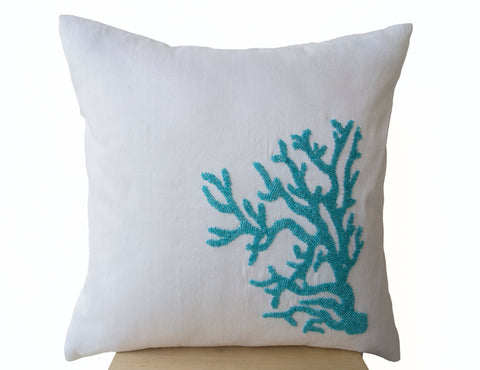 Handmade pillow cover in white silk with turquoise embroidery
