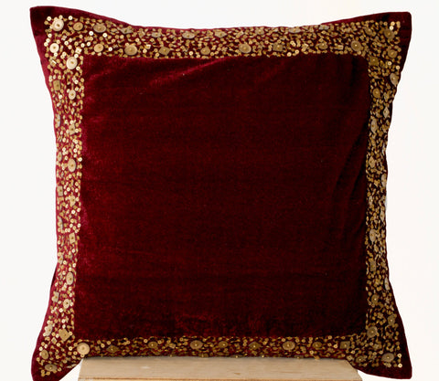 Handmade maroon velvet throw pillows with gold sequin border and beads