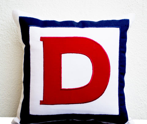 Monogrammed throw pillows in multiple colors