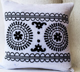 Handmade white pillow with black embroidery