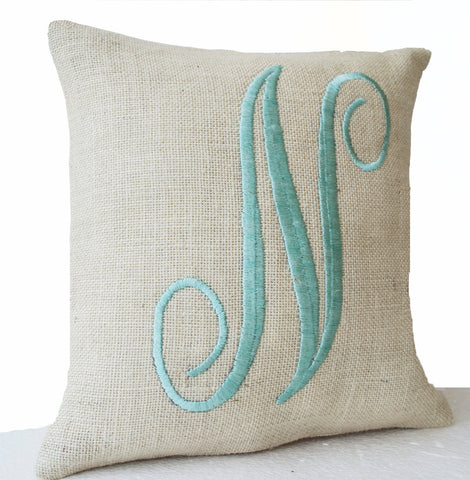 Handmade ivory throw pillow with mint embroidery and monogram