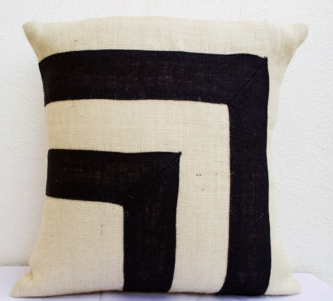 Handmade black ivory throw pillow with applique