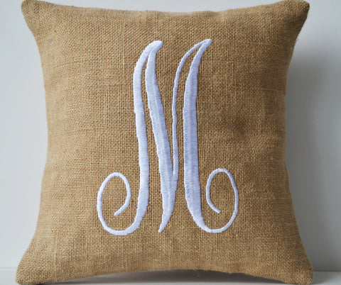 Monogram pillows in natural burlap with white embroidered letter design