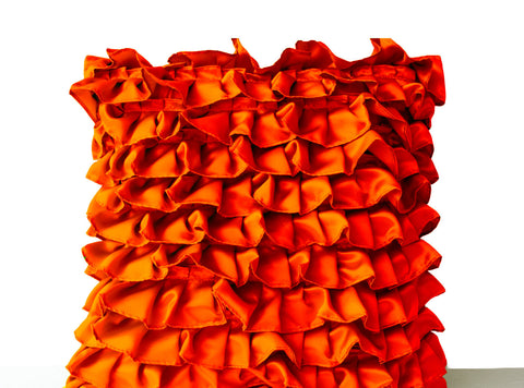 Handmade orange satin pillow covers with ruffles