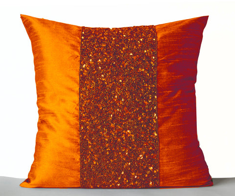Handmade orange silk throw pillows with beads and sequin