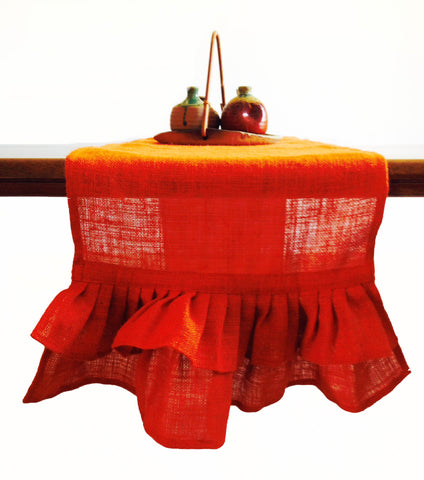 Burlap table runners in orange with ruffles