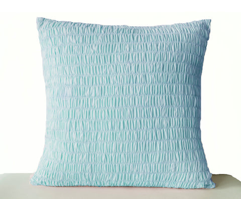 Handmade light blue cotton throw pillow with pleats