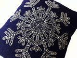 Handmade navy blue burlap cushion cover with silver beaded snowflake