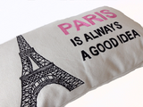 Handmade pink and black throw pillow with embroidered Eiffel Tower.